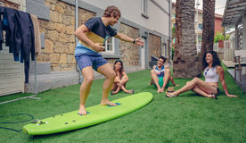 Group of people having fun in a surf class Royalty Free Stock Photography