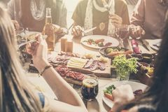 Group of people having meal togetherness dining royalty free stock photo