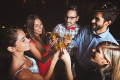 Group of people having a party on the roof, opening a champagne bottle Royalty Free Stock Photo