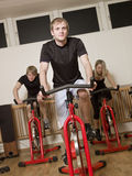 Group of people having spinning class Stock Images