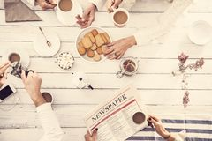 Group of people having tea time royalty free stock images