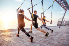Group of people having Trx training royalty free stock photography