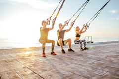 Group of people having Trx training Stock Photo