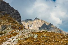 Group of people hiking in Five lakes valley in High Tatra Mountains, Poland Royalty Free Stock Image
