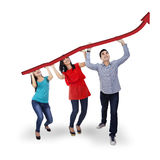 Group of people holding an arrow rising Royalty Free Stock Photography