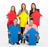 Group of people holding arrows Royalty Free Stock Photography