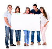 Group of people holding a banner Stock Images