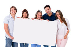 Group of people holding a banner Stock Photos