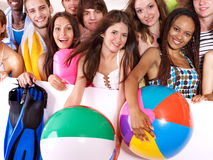 Group people holding beach accessories. Royalty Free Stock Photos