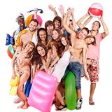 Group people holding beach accessories. Royalty Free Stock Photography