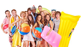 Group people holding beach accessories. Royalty Free Stock Photo