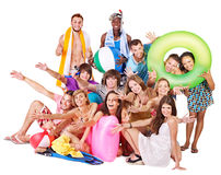 Group people holding beach accessories. Stock Photo