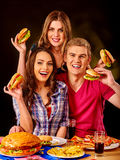 Group people holding big hamburgers Royalty Free Stock Photo