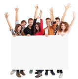 Group of people holding blank banner. Group of smiling friends holding blank banner Royalty Free Stock Image