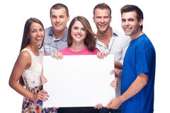 Group of people holding a blank billboard Royalty Free Stock Images