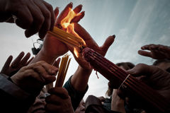 Group of People Holding Candle and Lighted on Lighter Royalty Free Stock Photo