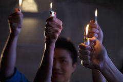 Group of people holding cigarette lighters at a concert Stock Photography