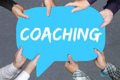 Group of people holding coaching and mentoring education trainin. Group of people holding with hands the word coaching and mentoring education training workshop royalty free stock photo