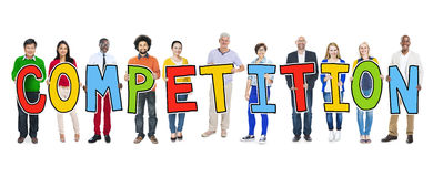 Group of People Holding Competition Letter Concept Royalty Free Stock Photo