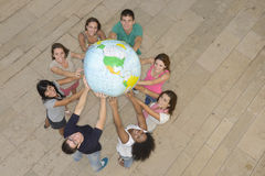 Group of people holding  the Earth Globe Stock Photo