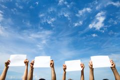 Group of people holding empty blank paper signs royalty free stock photography