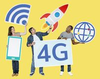 Group of people holding 4G technological icons Royalty Free Illustration