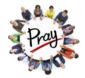 Group of People Holding Hands around Letter Pray.  Royalty Free Stock Photo