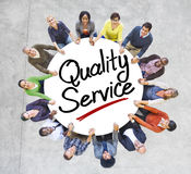 Group of People Holding Hands Around Quality Service.  Royalty Free Stock Photo