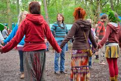 Group of people holding hands in a circle, harmony. OELEGHEM, BELGIUM, 30 AUGUST 2014:Unidentified Group of people holding hands in a circle, harmony at a party Stock Photos