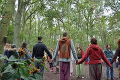 Group of people holding hands in a circle, harmony. OELEGHEM, BELGIUM, 30 AUGUST 2014:Unidentified Group of people holding hands in a circle, harmony at a party Stock Images