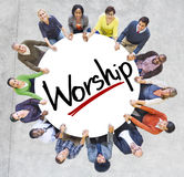 Group of People Holding Hands with Word Worship Stock Image