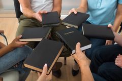 Group of people holding holy bible Stock Photography