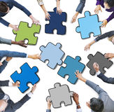 Group of People Holding Jigsaw Puzzle in Photo and Illustration.  Stock Images