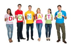 Group of people holding letter donate Royalty Free Stock Images
