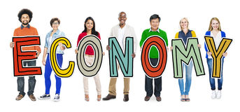 Group of People Holding Letter Economy Concepts Stock Photo