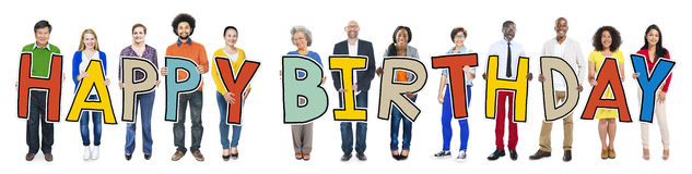Group of People Holding Letter Happy Birthday Stock Image