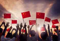Group of People Holding National Flags of China Stock Photos