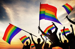 Group of People Holding Rainbow Flags Royalty Free Stock Image