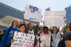 Group of people holding signs and blowing whistles Royalty Free Stock Image