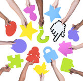 Group of people holding social media and communication symbol Stock Image