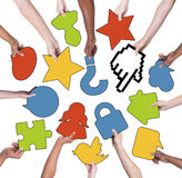 Group of People Holding Social Networking Symbols Stock Images