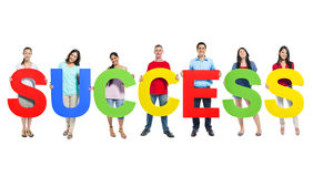 Group of people holding success Stock Photos