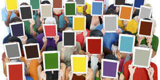 Group of People Holding Tablets in Front of Faces Stock Images