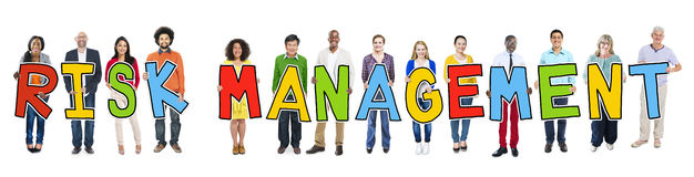 Group of People Holding Text Risk Management Stock Photos