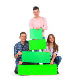 Group of people holding tree shaped papers Royalty Free Stock Image