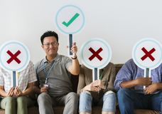 Group of people holding true & false icons stock image