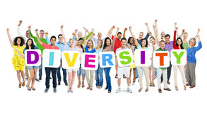 Group of People Holding Word Diversity. Multi-ethnic group of arms outstretched people holding cardboards forming diversity Stock Image