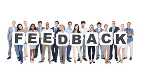 Group of People Holding Word Feedback Royalty Free Stock Images