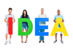 Group of People Holding Word Idea Stock Image