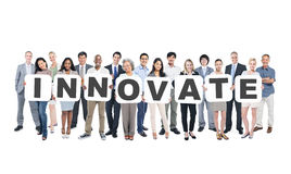 Group Of People Holding Word Innovate Royalty Free Stock Photography